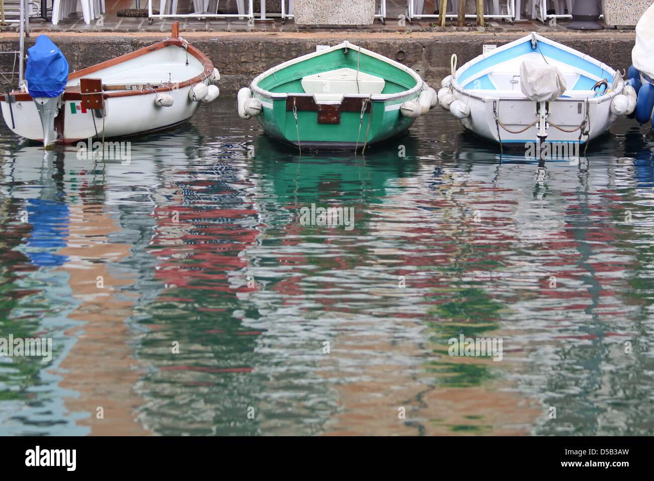 Rowing boats in the harbor of Desenzano on Lake Garda, Region of Brescia, Lombardy, Italy - Stock Image