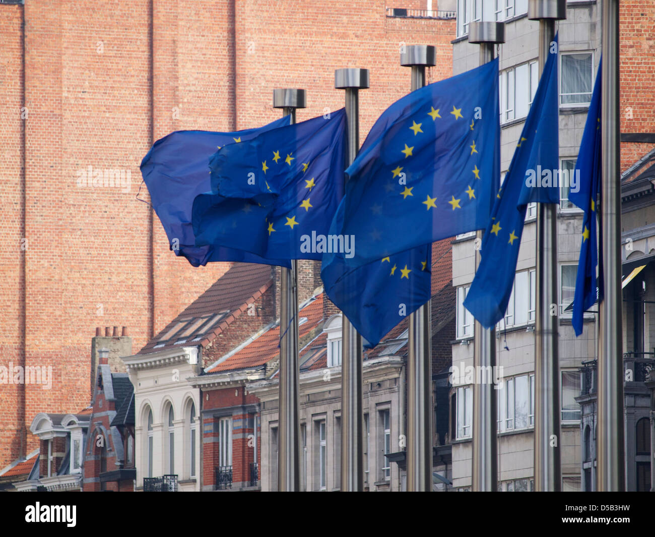 European Union flags in the wind with old buildings in the background. Brussels, Belgium - Stock Image