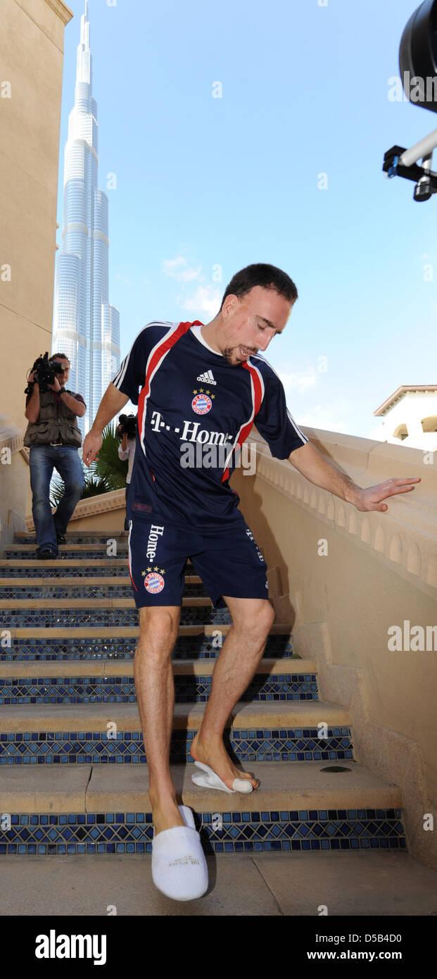 Franck Ribéry of German Bundesliga soccer club FC Bayern Munich walks down stairs in Dubai, United Arab Emirates, - Stock Image