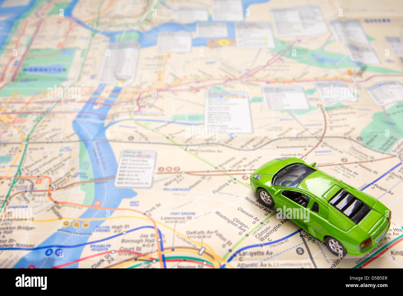 Green Toy Car On Map Of New York City Travel Or Traffic Concept