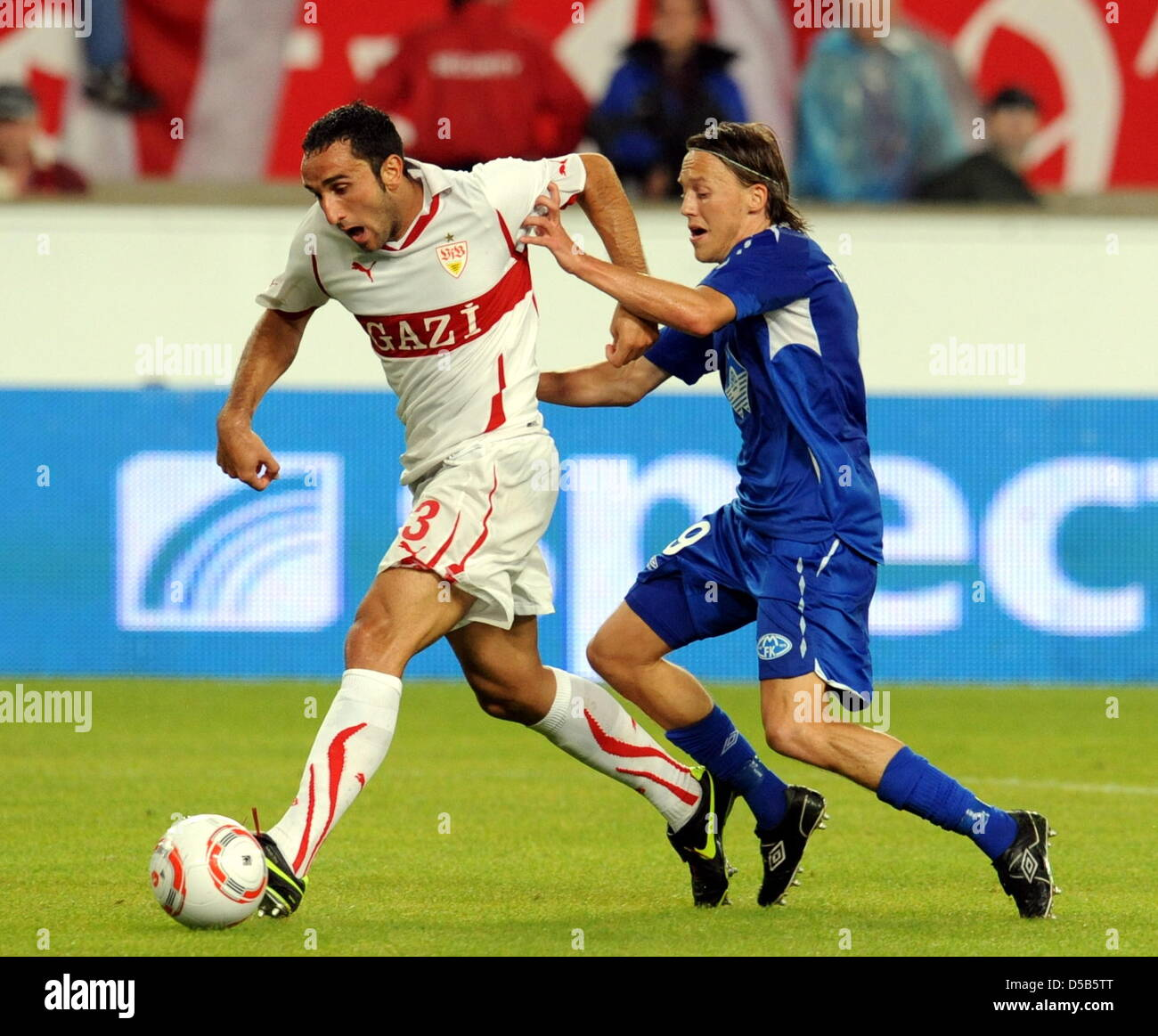 Stuttgart's player Cristian Molinaro (L) is locked in a fight for the ball with Mold FK's player Mattias Mostrom Stock Photo
