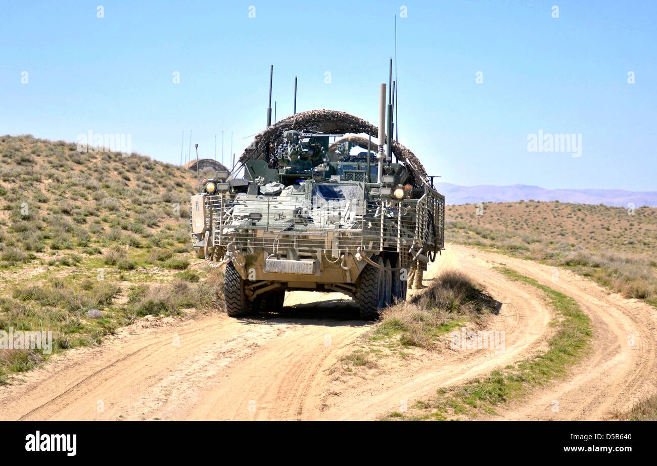 USA Stryker armored vehicle provides security as Afghan Border Police break ground on a new checkpoint March 25, - Stock Image