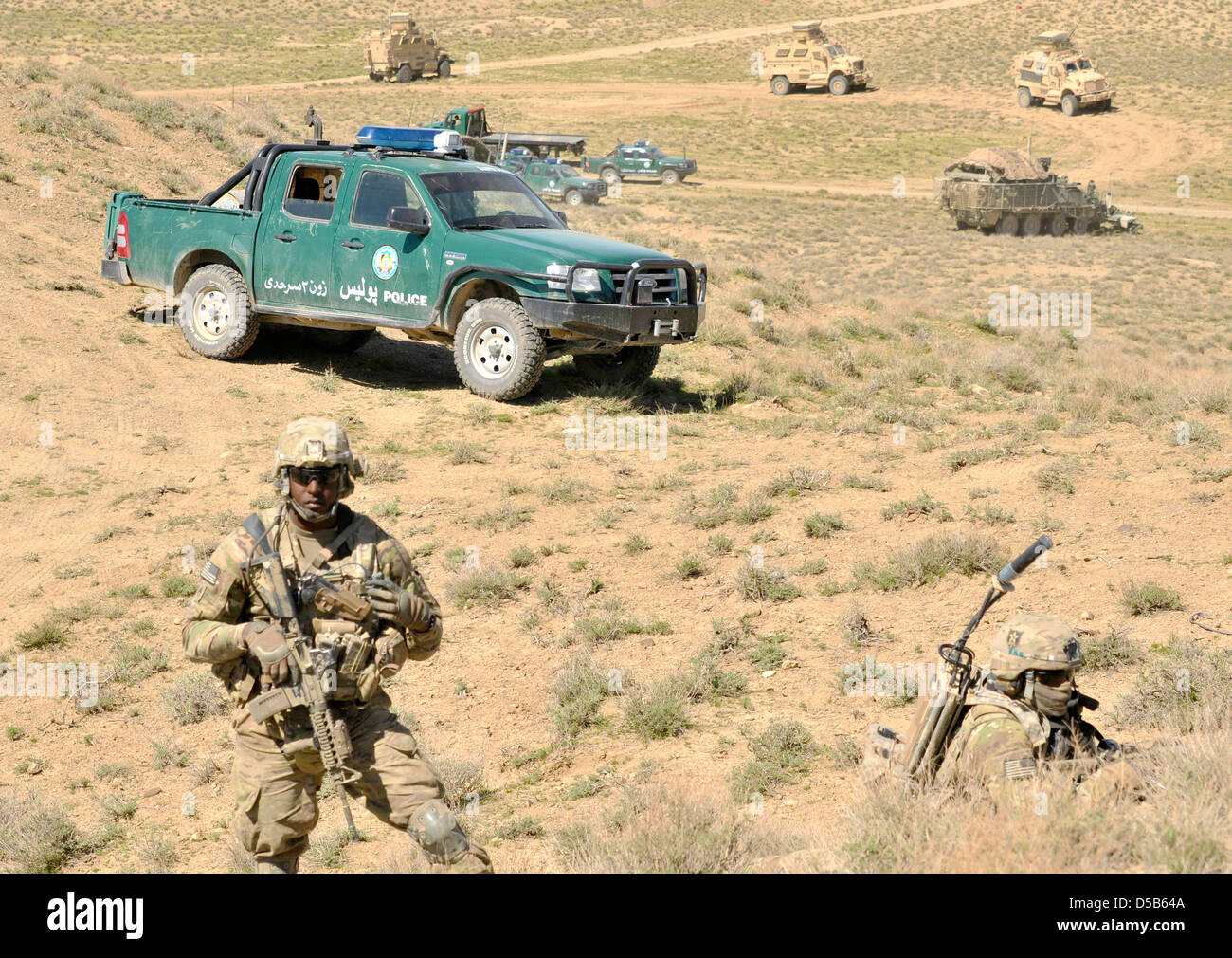 US Army soldiers provide security as Afghan Border Police break ground on a new checkpoint March 25, 2013 in the - Stock Image