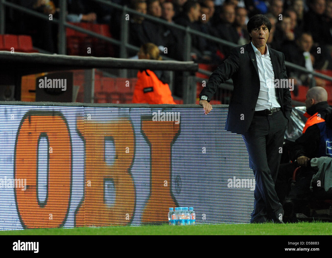 German national trainer Joachim Loew stands on the sidelines of the soccer field during the international soccer - Stock Image