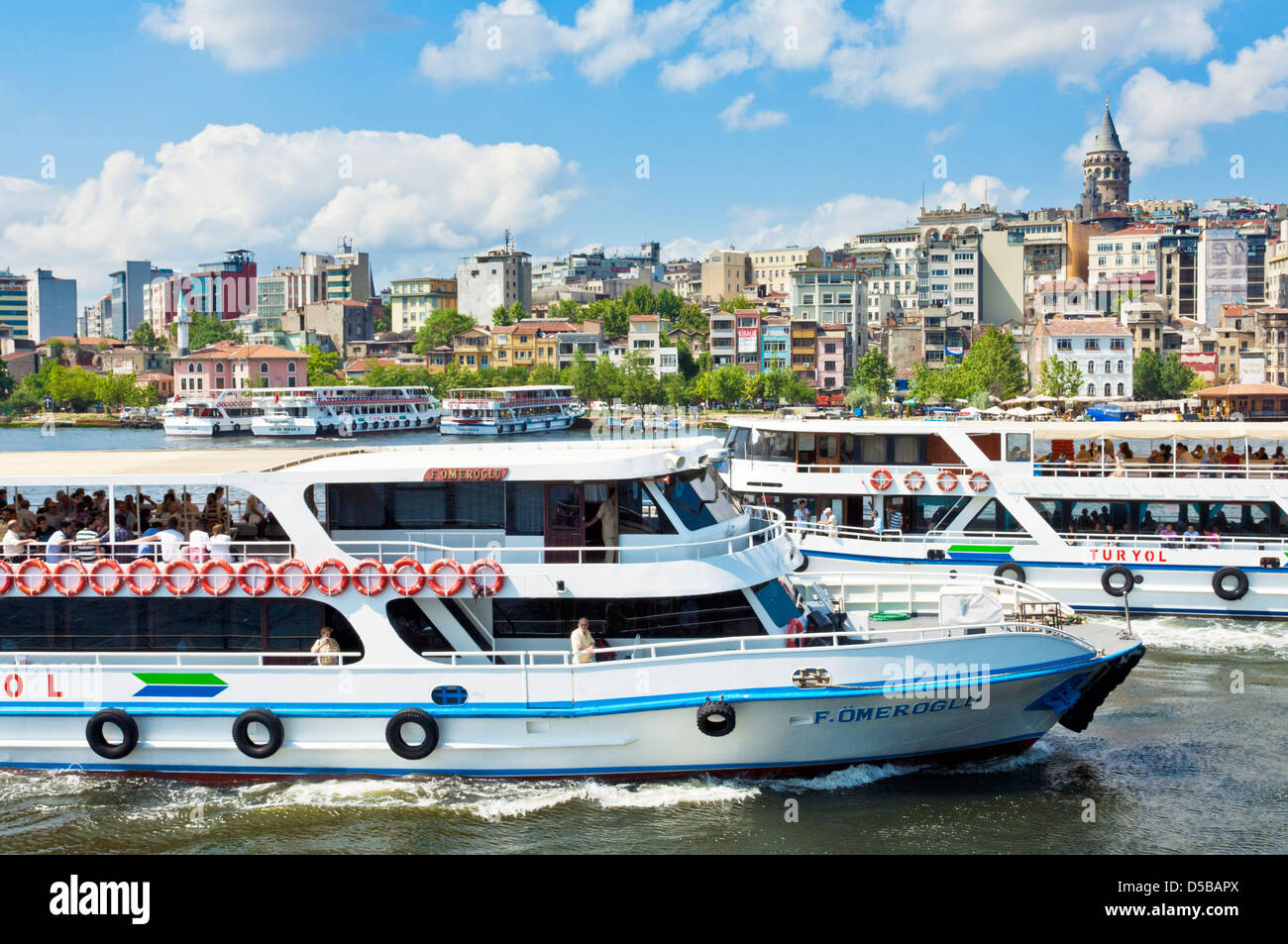 Cruise Boats on the Bosphorus River and The Beyoglu Skyline, central Istanbul, Turkey, Europe - Stock Image