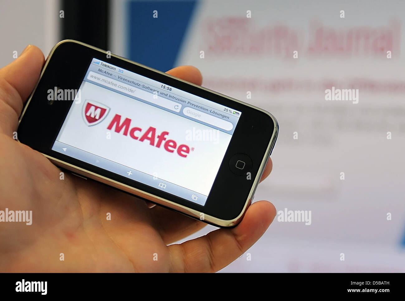 The logo of antivirus specialist McAfee is captured on an iPhone