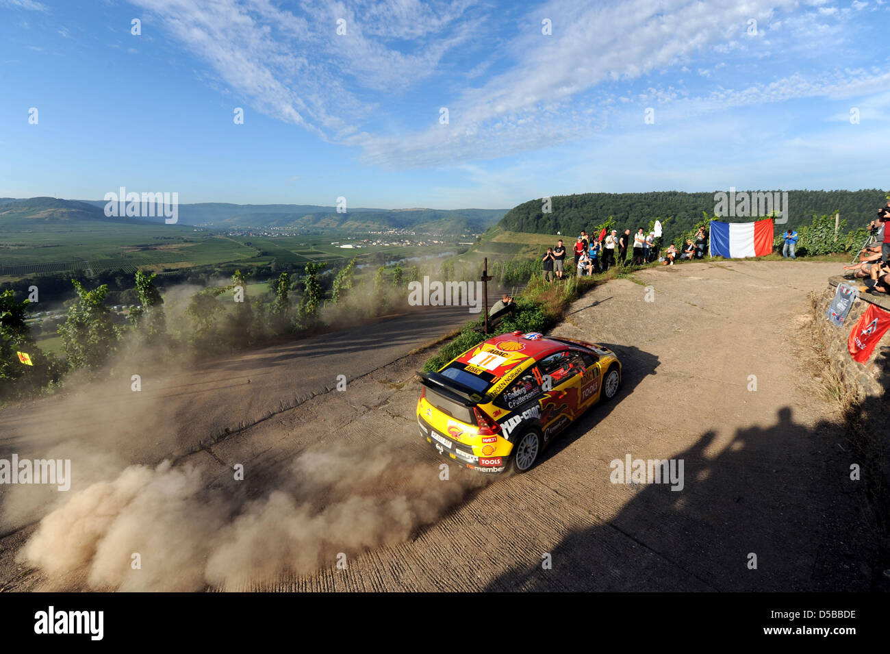 Norwegians Petter Solberg and co-driver Chris Patterson race in their Citroen C4 WRC in the Mosel vineyards during - Stock Image