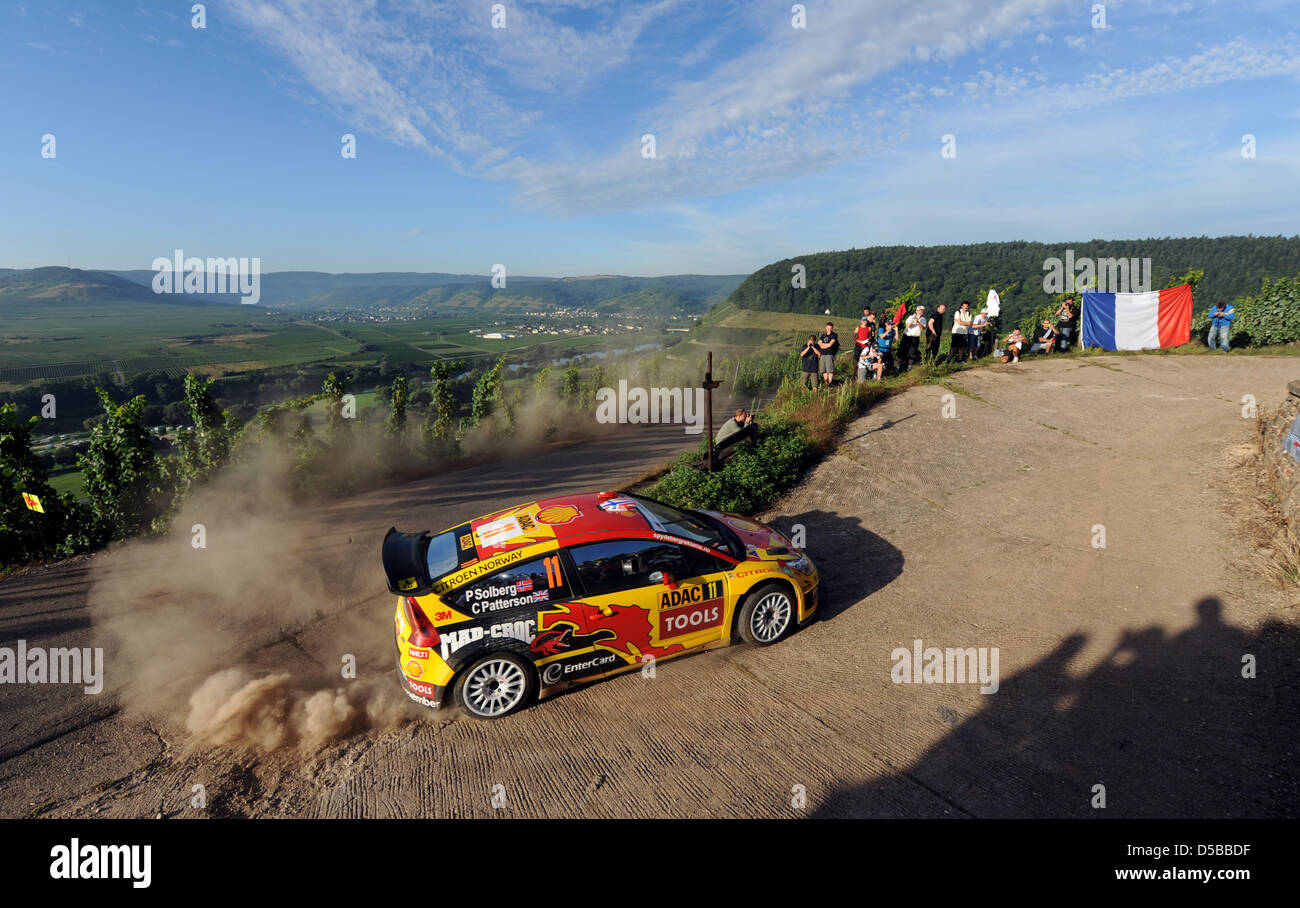 Norwegians Petter Solberg and British co-driver Chris Patterson race in their Citroen C4 WRC in the Mosel vineyards - Stock Image