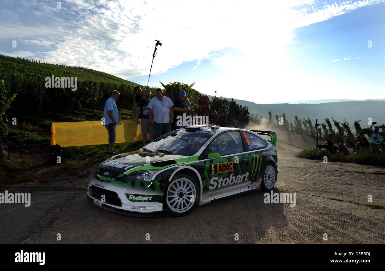 British Matthew Wilson and co-driver Scott Martin drift in their Ford Focus RSWRC in the Mosel vineyards during - Stock Image