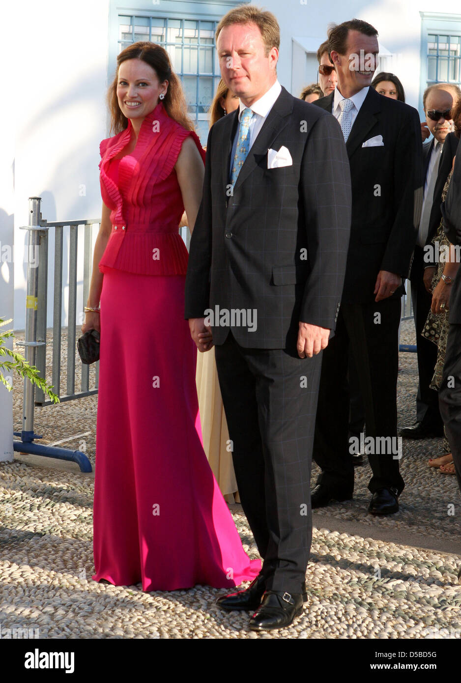 Prince Gustav of Sayn-Wittgenstein-Berleburg and his fiancee Carina Axelsson arrive at the Agios Nikolaos church for the wedding ceremony of Nikolaos, son of the former Greek king, and his bride Tatiana Blatnik on Spetses Island, Greece, 25 August 2010. The couple got married in the whitewashed 19th-century cathedral. The wedding was attended by royals from all over Europe, includi Stock Photo