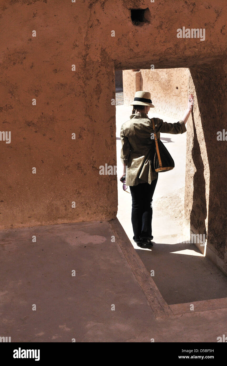 Newly wed admires wedding ring , poses for husbands camera in the door arch of  the remnants el Badi Palace Marrakesh,Morocco, - Stock Image