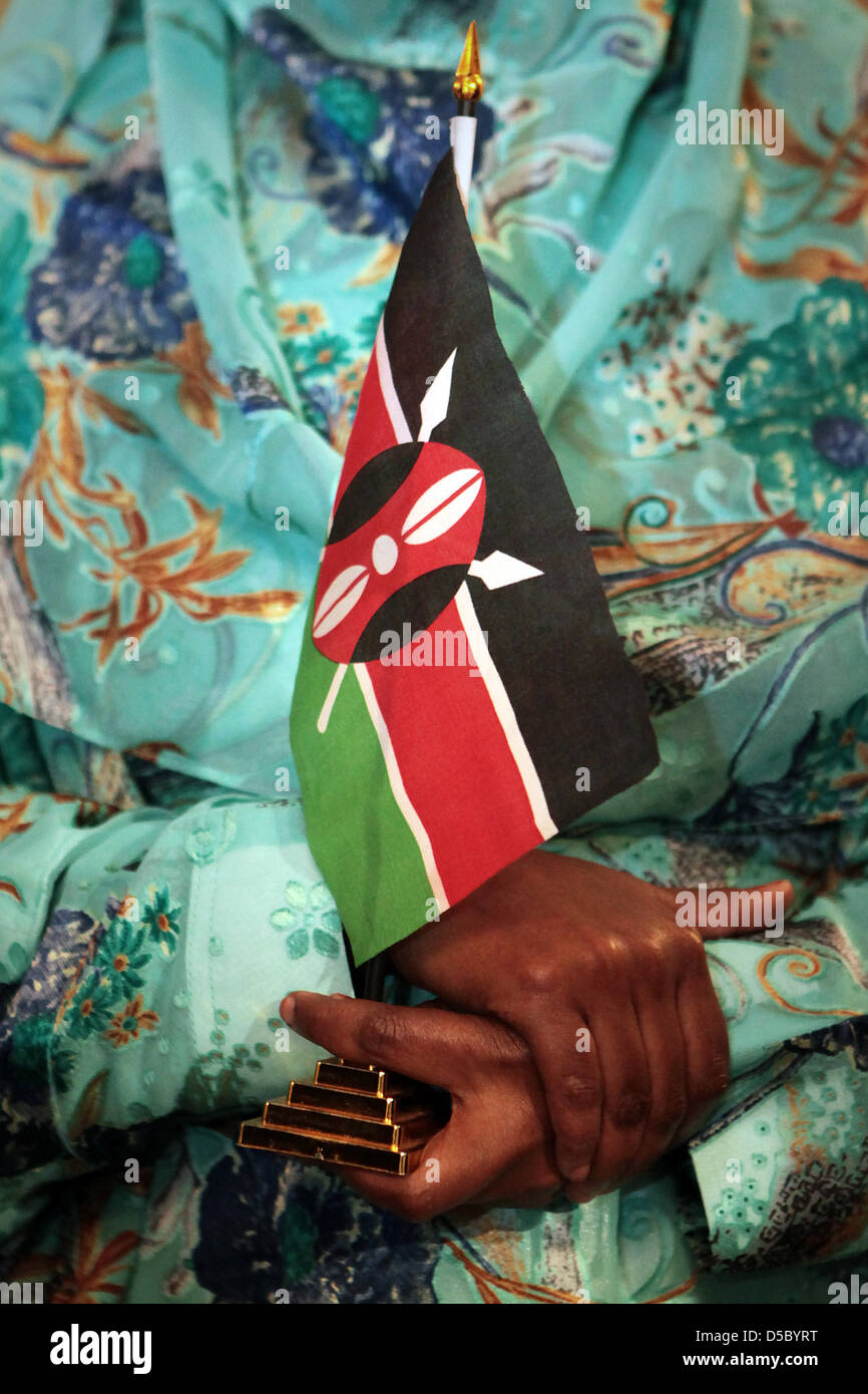 Kenyan peace activist Dekha Ibrahim Abdi holds a Kenyan flag in Wiesbaden, Germany, 21 January 2010. The Hessian Stock Photo