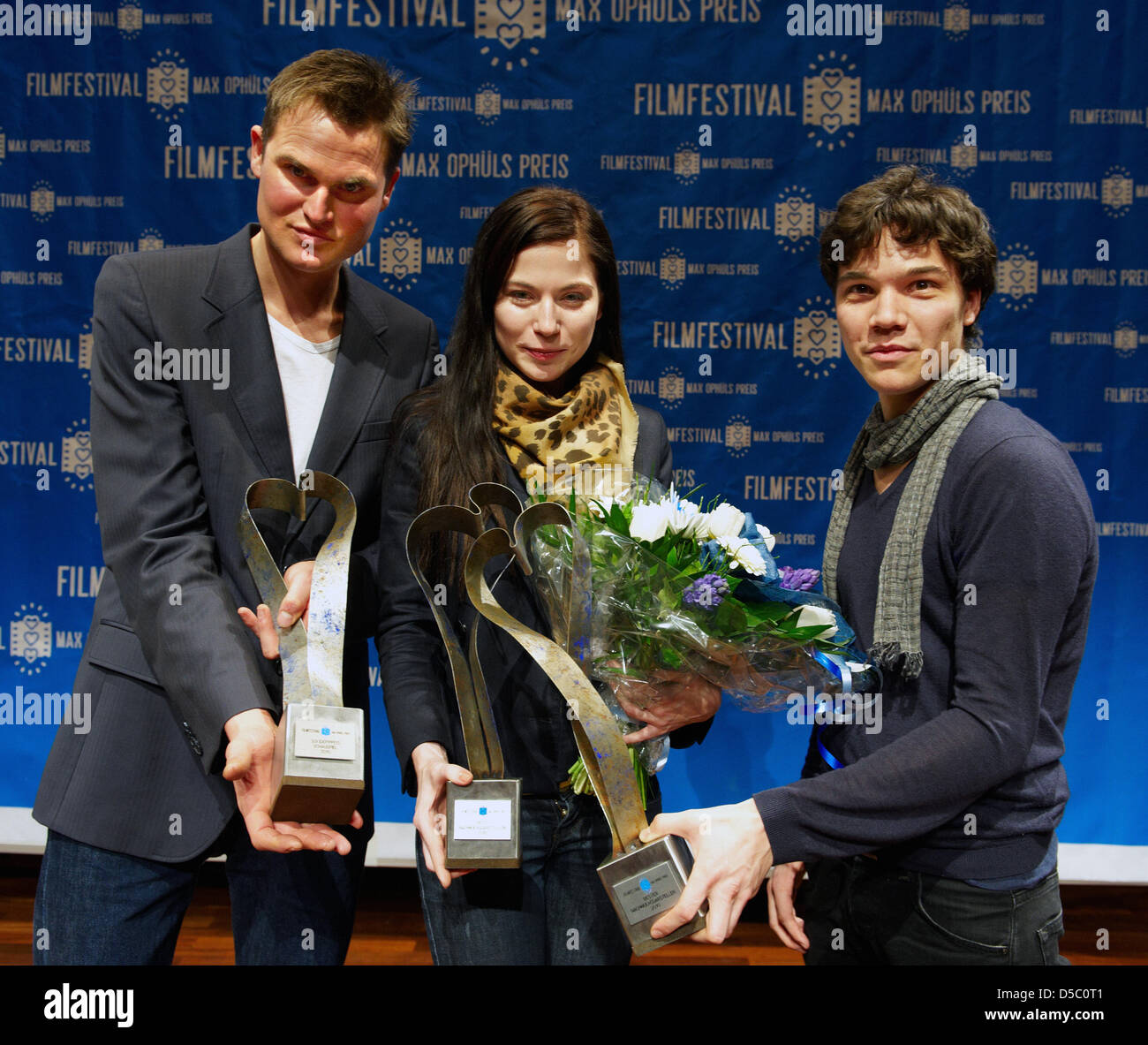 (L-R) German actor Fabian Hinrichs, Austrian actres Nora von Waldstaetten and German actor Sebastian Urzendowsky - Stock Image