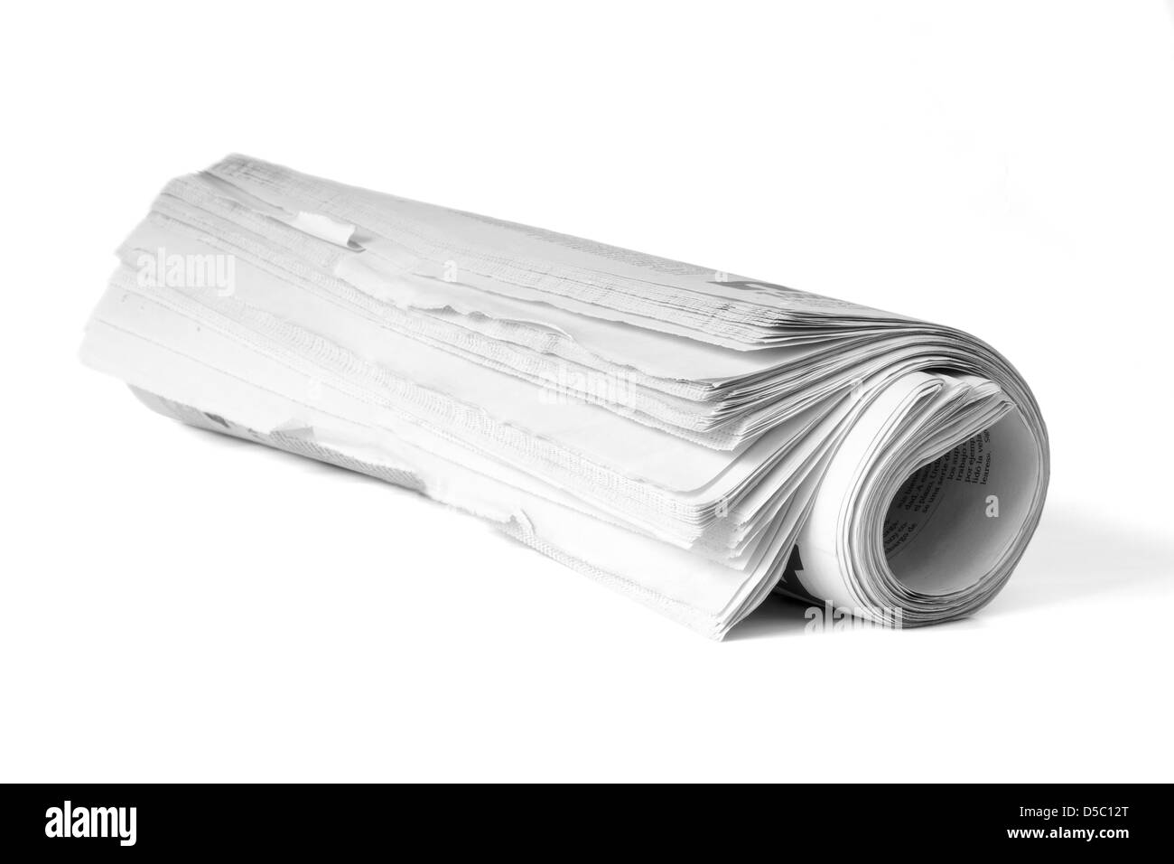 Roll of newspaper on a white background - Stock Image