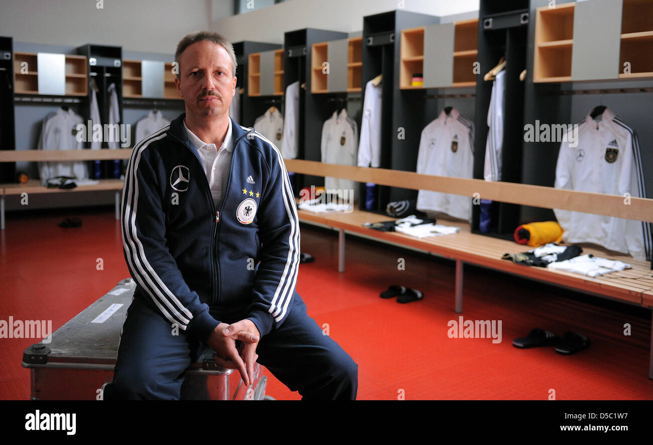 Germany's national team kitman Thomas Mai sits in the dressing room during the shoot of the German national - Stock Image