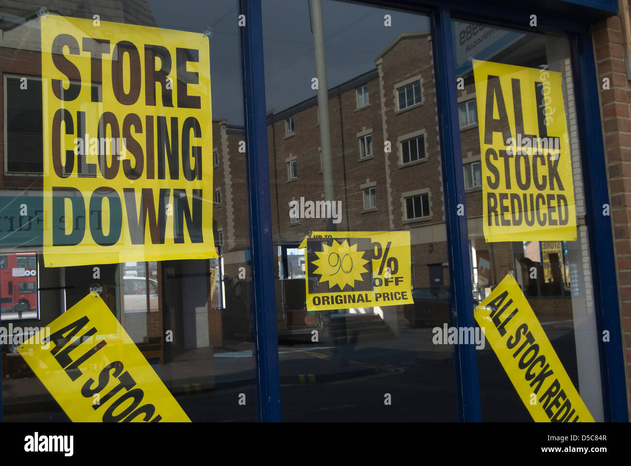 store closing down posters in shop window, kingston upon thames, surrey, england - Stock Image