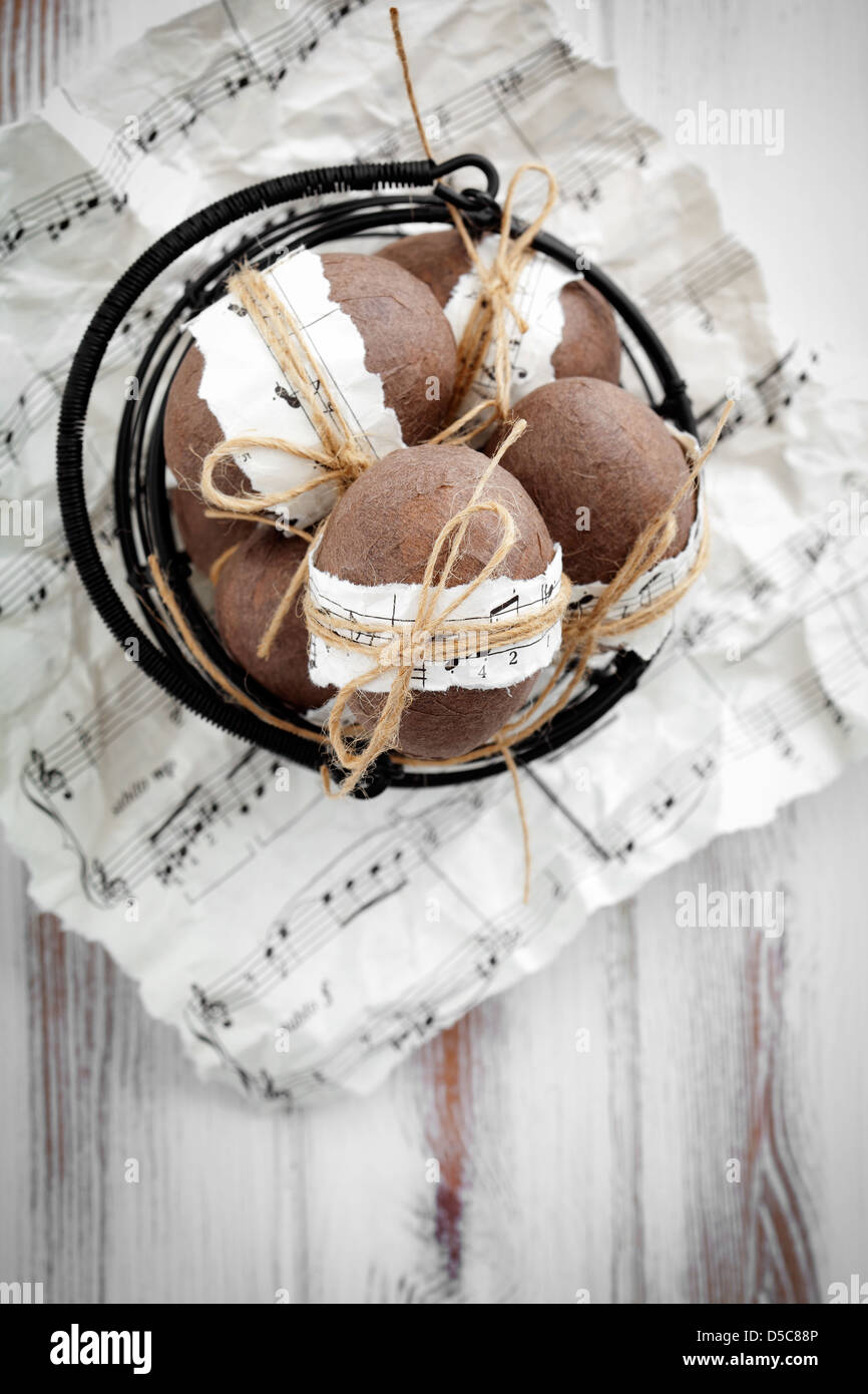Brown easter eggs with musical notes and ribbon - Stock Image