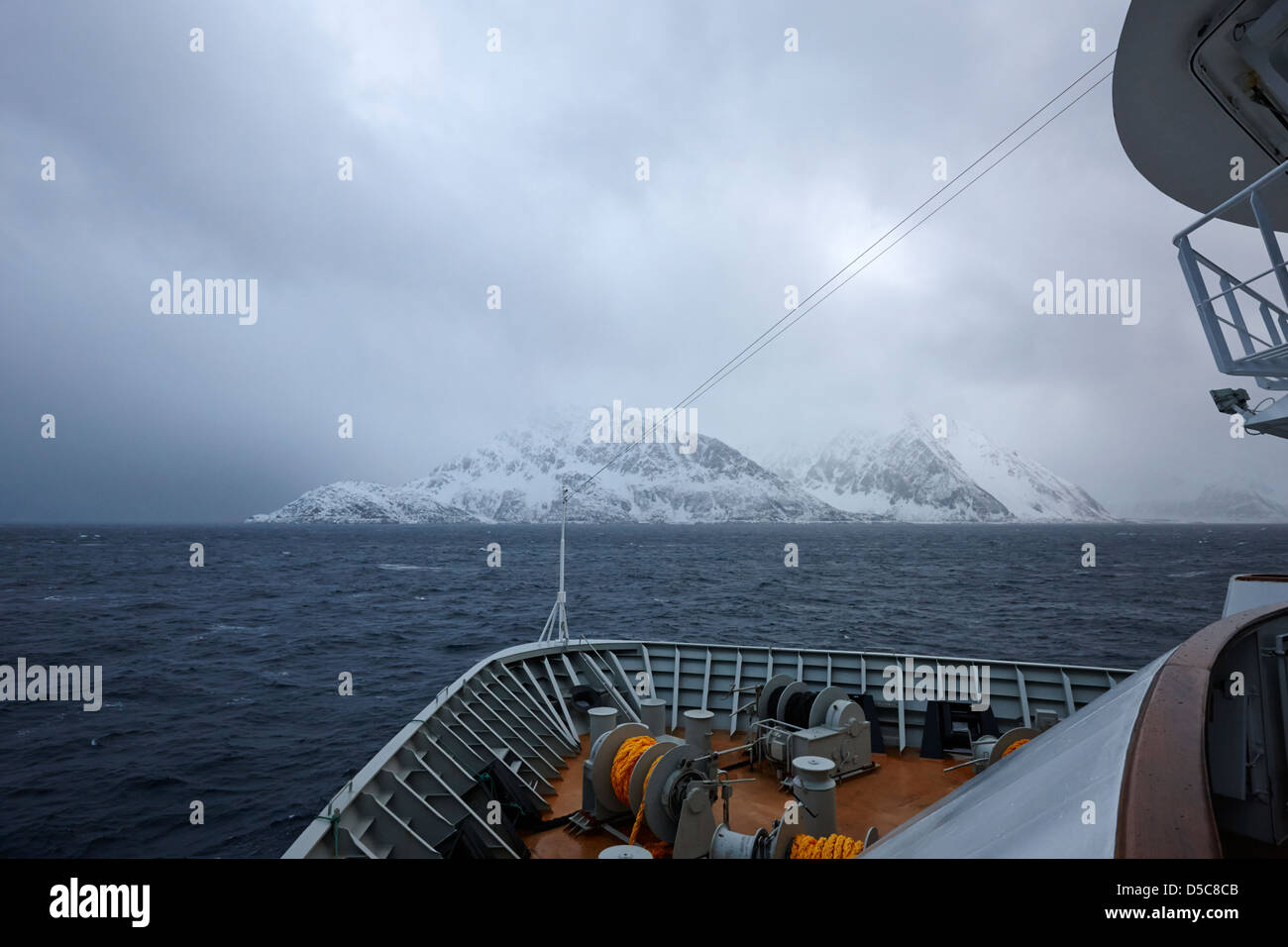 passenger ship sailing along the coast of the norwegian sea during winter norway europe - Stock Image
