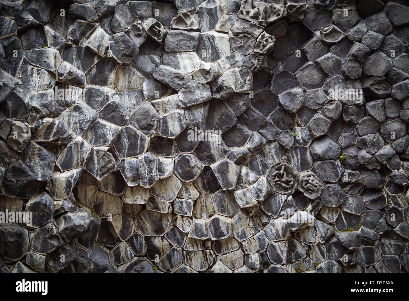 Hexagonal and pentagonal baslatic columns are the remains of old volcanic activity in Jokulsargljufur National Park - Stock Image