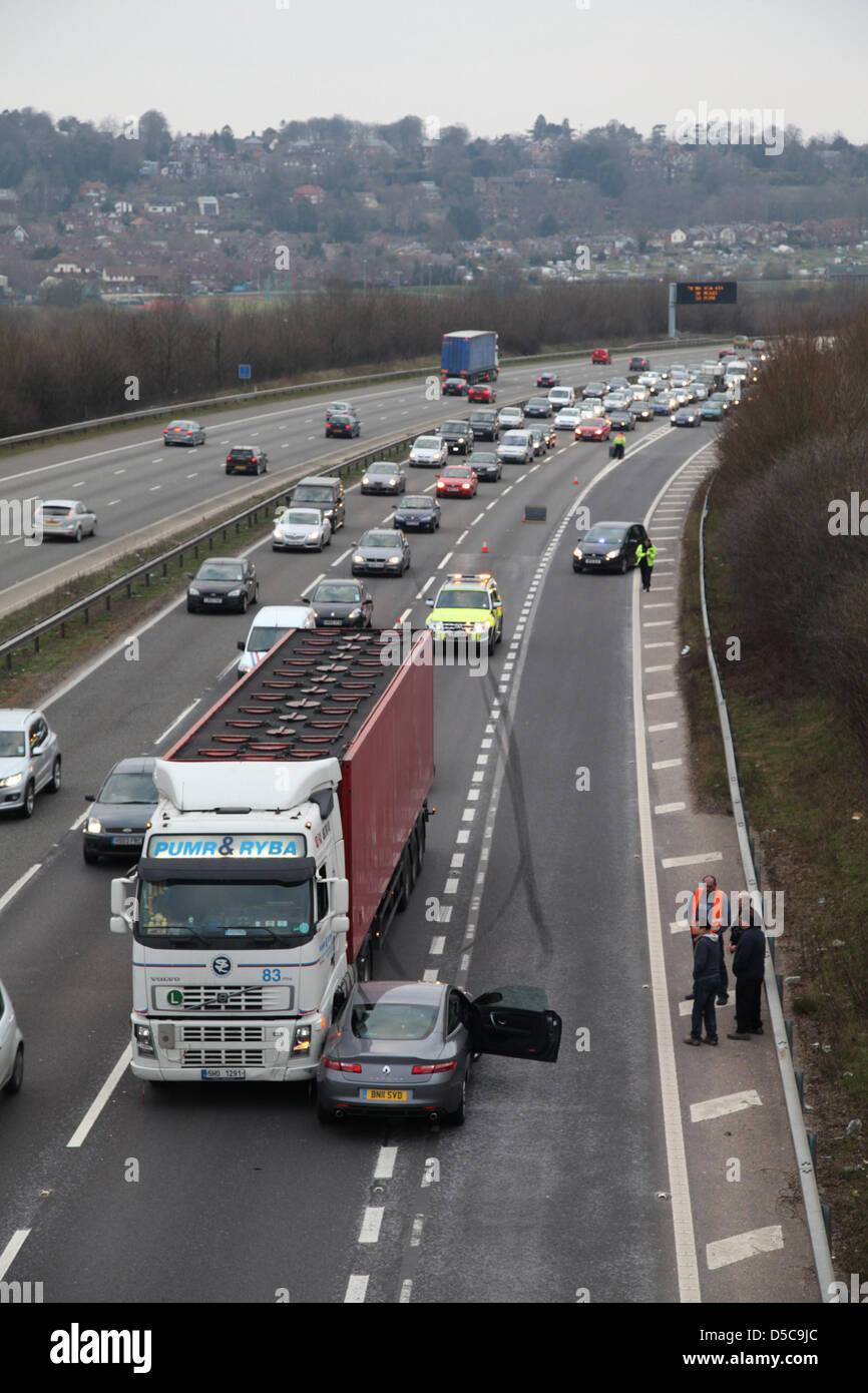 Winchester,UK. 28 March 2013 - Police & highway patrol attending an incident on the M3 motorway between Jct. - Stock Image