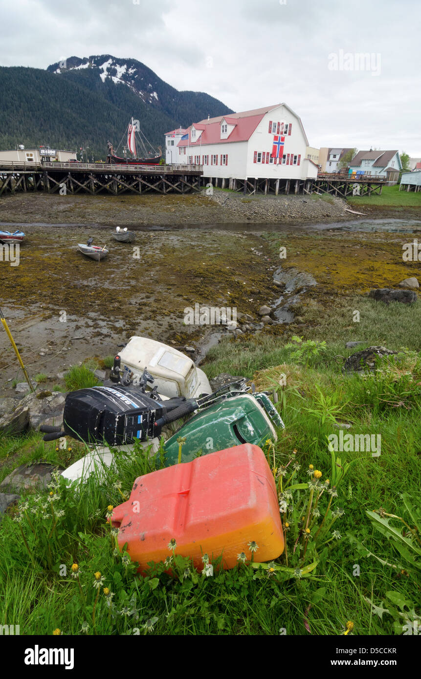 Outboard motors and gas can above slough in Petersburg, Alaska. - Stock Image