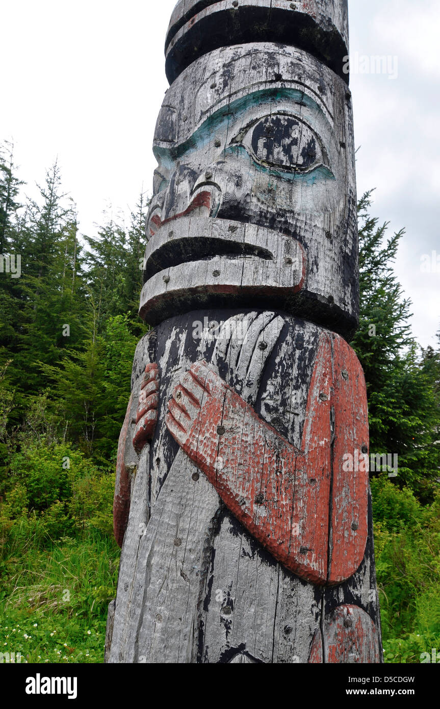 Tlingit totem pole in Kake, Alaska. At 132' it is the tallest properly sanctioned totem pole in the world. Stock Photo