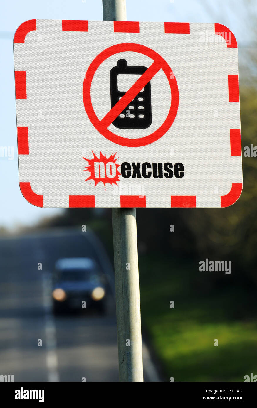 Texting While Driving >> No Excuse Road safety sign, no mobile phone whilst driving sign, UK Stock Photo: 54979080 - Alamy