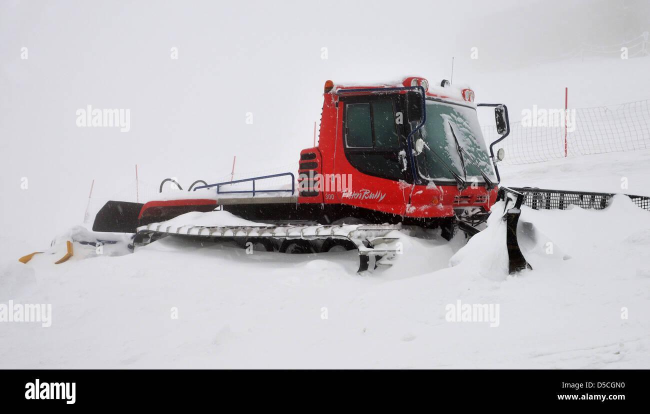 Snowplow, Snow plough, snow plow, snowplough in the snow in Poland. - Stock Image