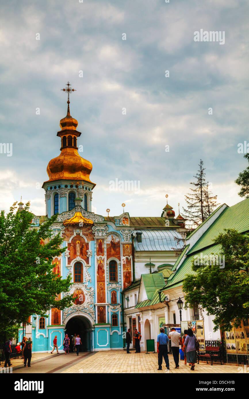 Kiev Pechersk Lavra monastery with tourists in Kiev, Ukraine - Stock Image