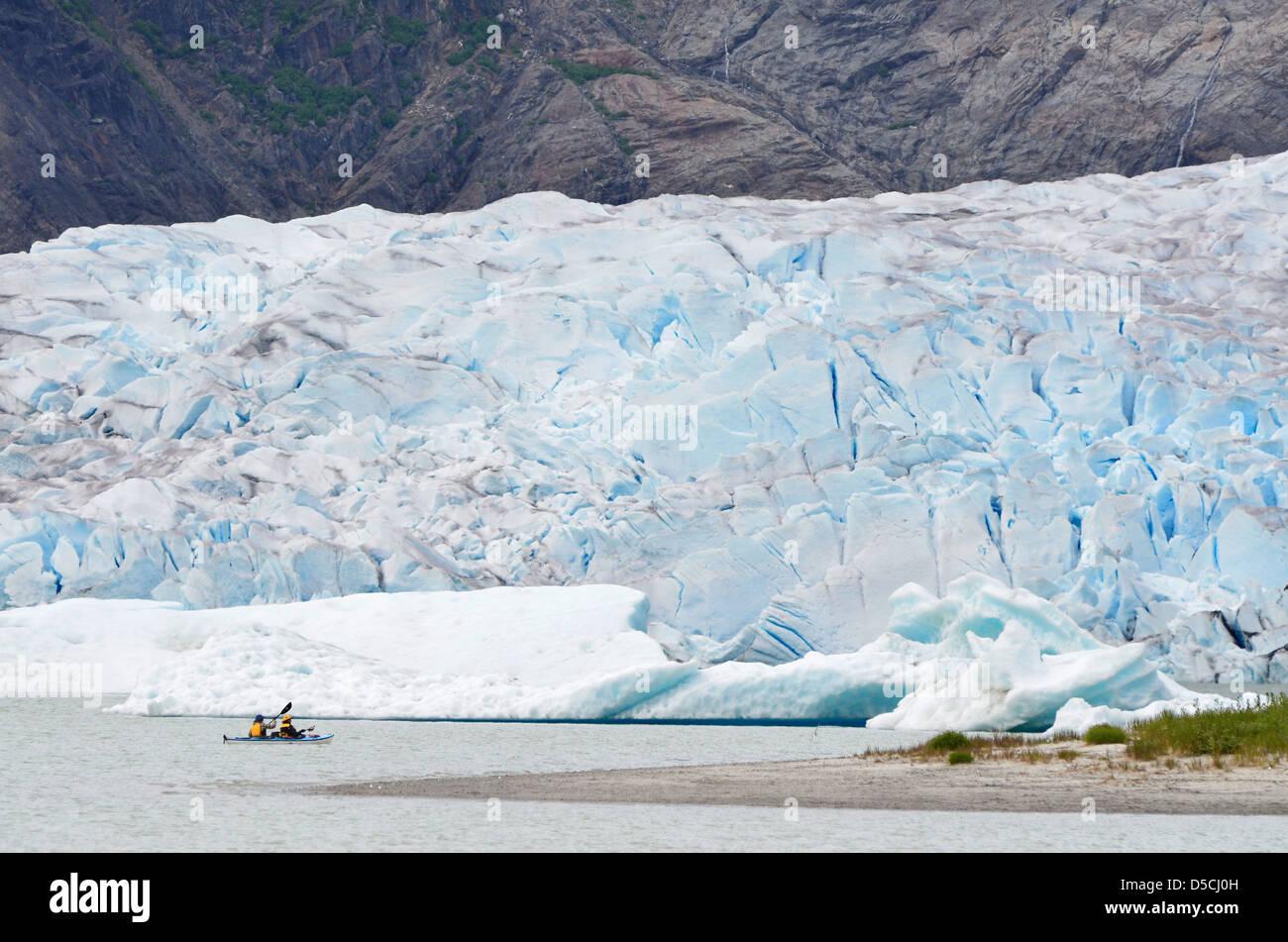 Sea kayaking below the Mendenhall Glacier in Southeast Alaska. - Stock Image
