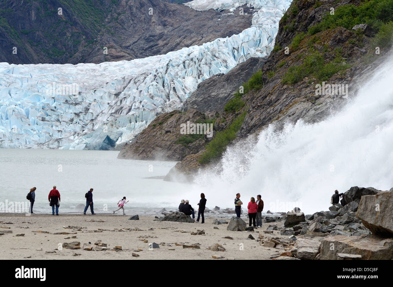 Tourists at Nugget Falls, Mendenhall Glacier Recreation Area, Alaska. - Stock Image