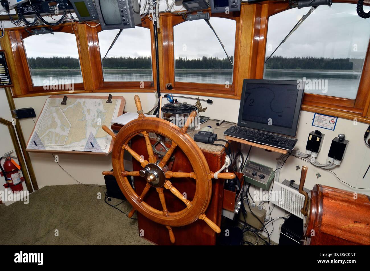 Wheelhouse of a small tour boat in Glacier Bay, Alaska. - Stock Image