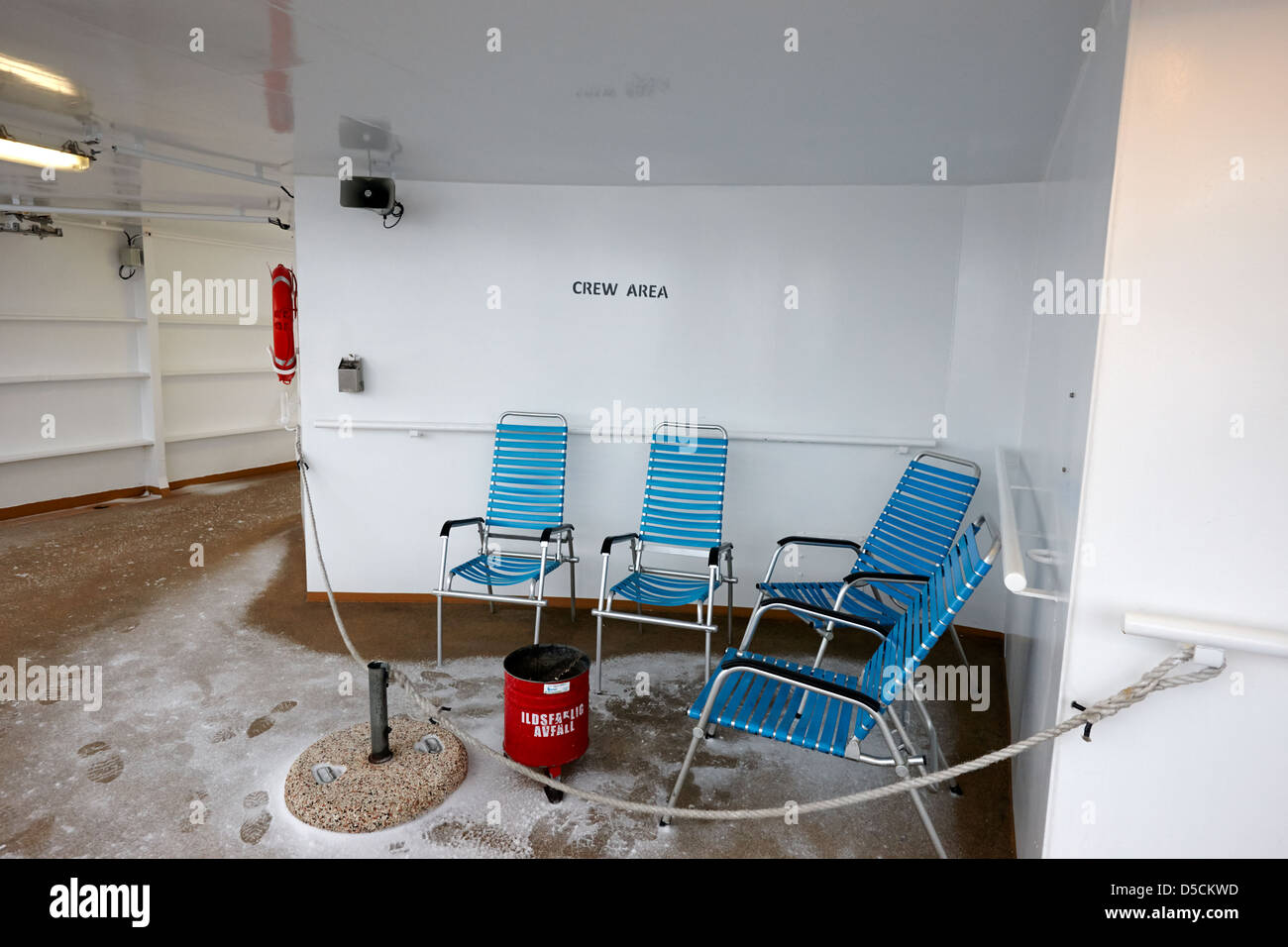 empty ships crew outdoor smoking area in snow on ship norway europe Stock Photo