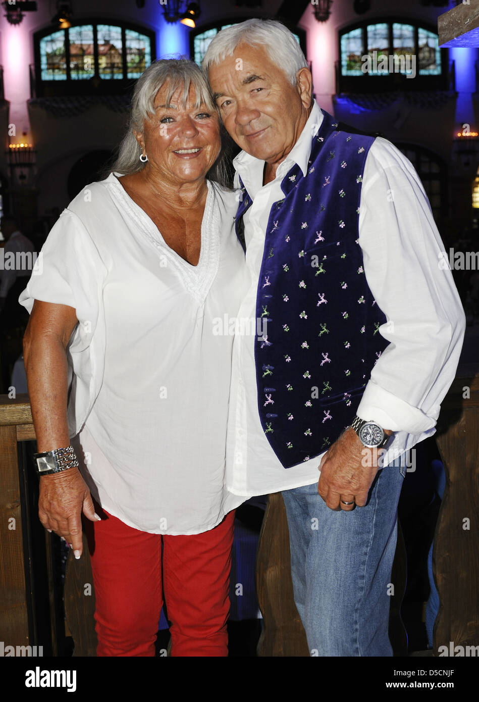 Gus Backus and his wife Heidelore at the Angermaier fashion event at Loewenbraeukeller. Munich, Germany - 01.09.2011 Stock Photo