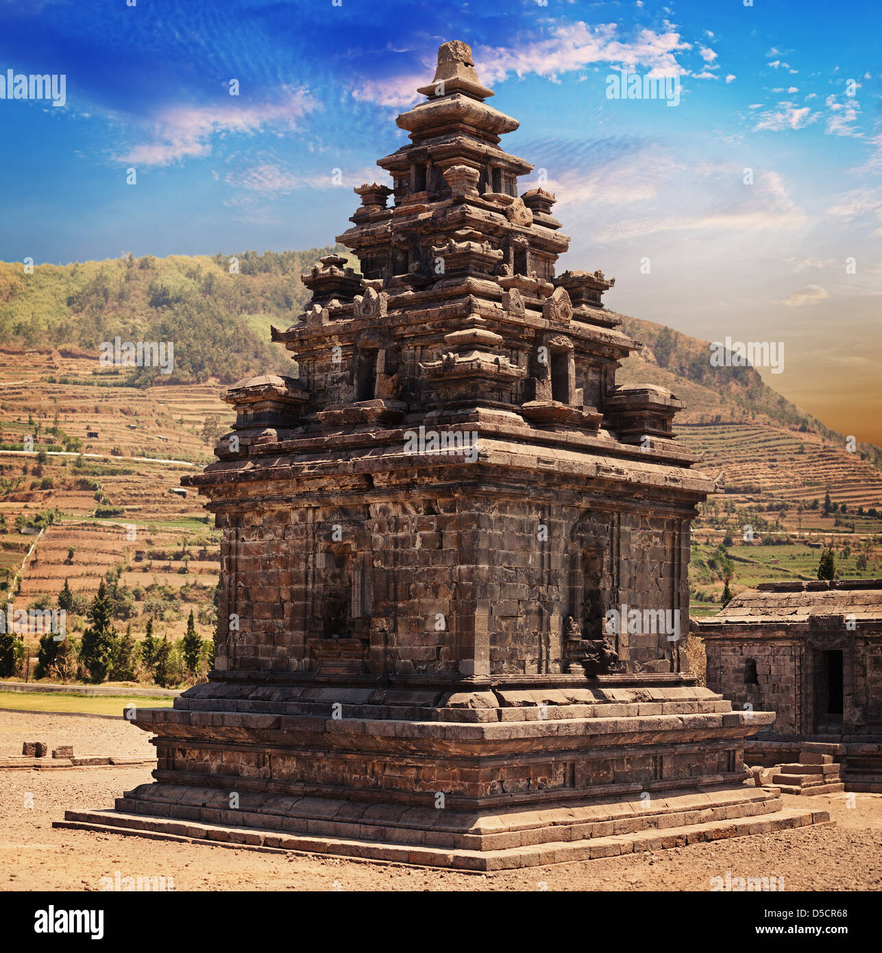Old stone small Hindu temple candi Arjuna, Dieng Plateau, Java, Indonesia (built around 750 CE) - Stock Image