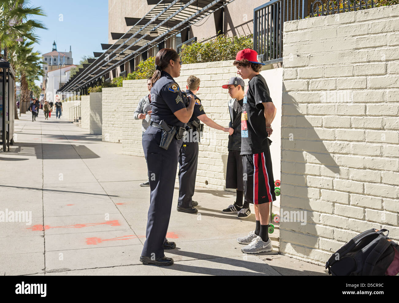 Teenagers getting arrested on the streets. - Stock Image