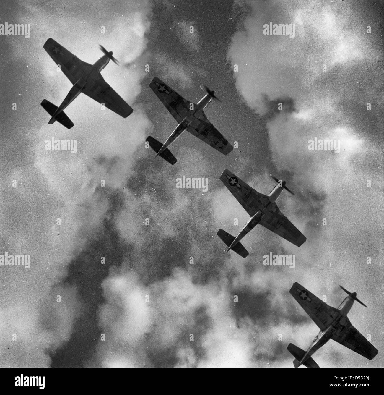 Four P-51 Mustangs flying in formation. Ramitelli, Italy, March 1945 - Stock Image