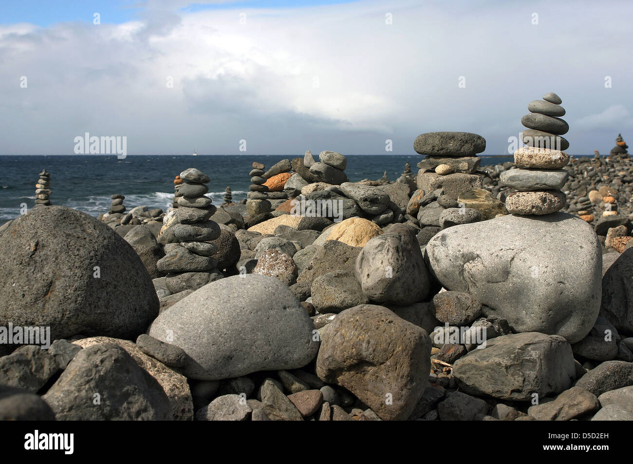 Los Cristianos, Spain, stacked stones at the coast - Stock Image