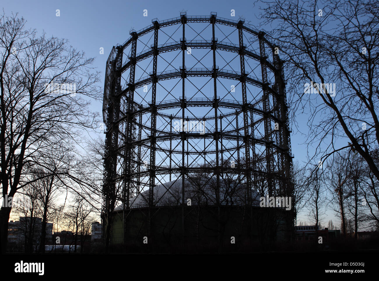 Berlin, Germany, the silhouette of the Gasometer Schoeneberg at dusk - Stock Image