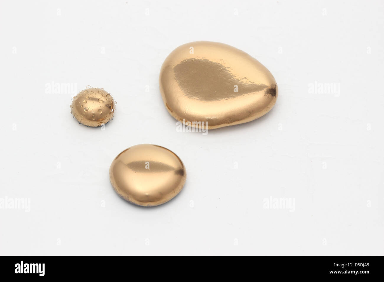 Richness of gold pebbles or nuggets - Stock Image