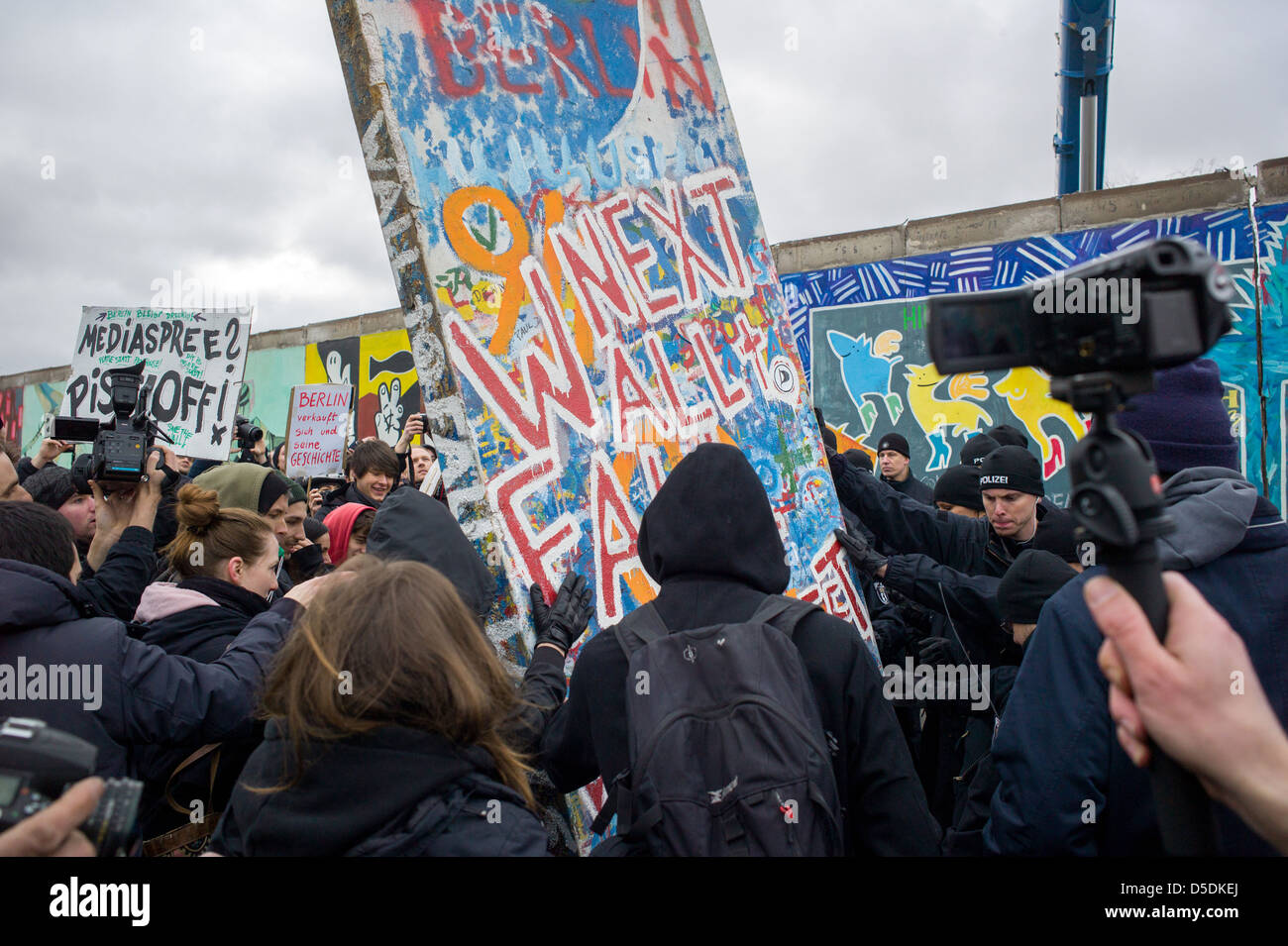 Berlin, Germany, demonstrators with a wall segment papier-mâché - Stock Image