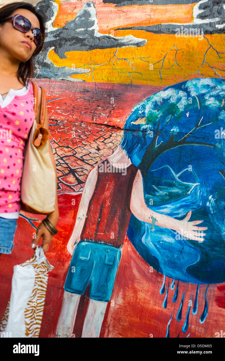 Young woman blending in with the graffiti in the background Stock Photo