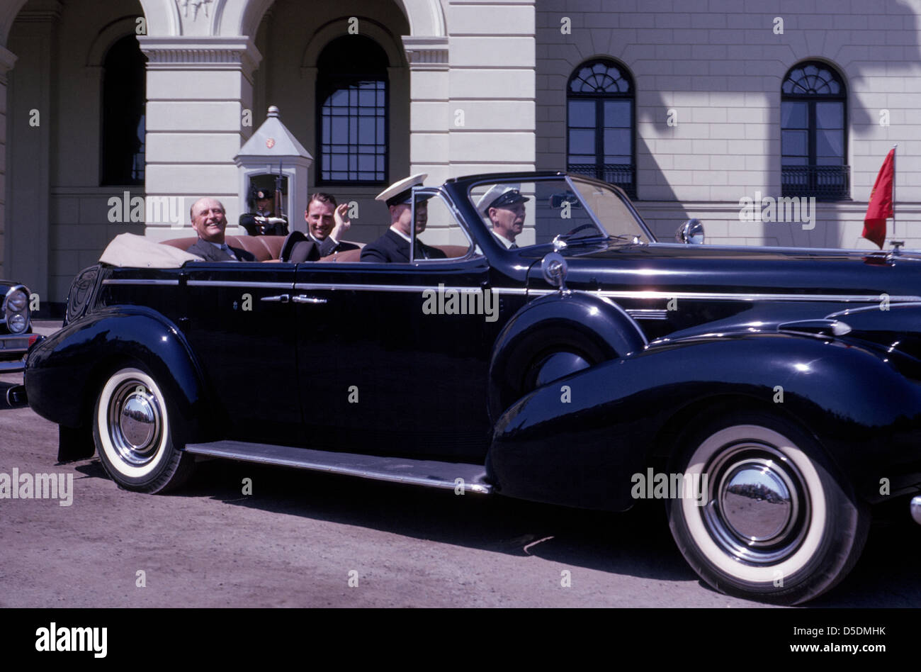 On his birthday in 1963, the King of Norway, Olav V, and his only son, Crown Prince Harald, ride in the open royal Stock Photo