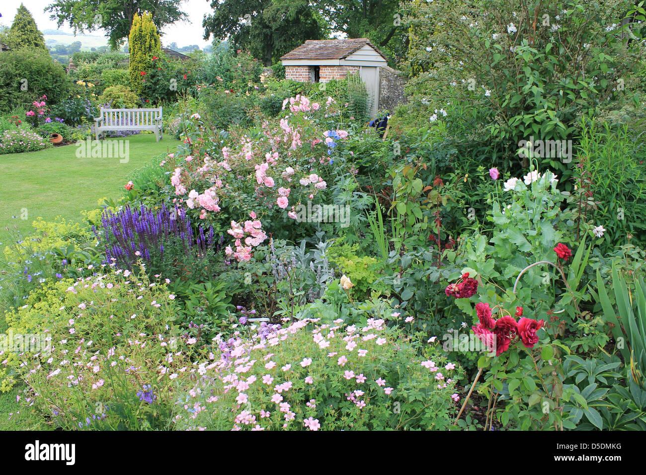 Beautiful English cottage garden at Exton, Hampshire, UK - Stock Image