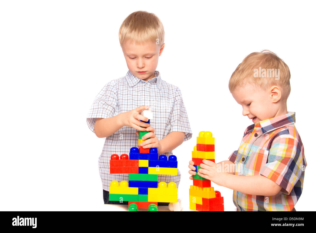 boys brothers children build play constructor plastic creative - Stock Image