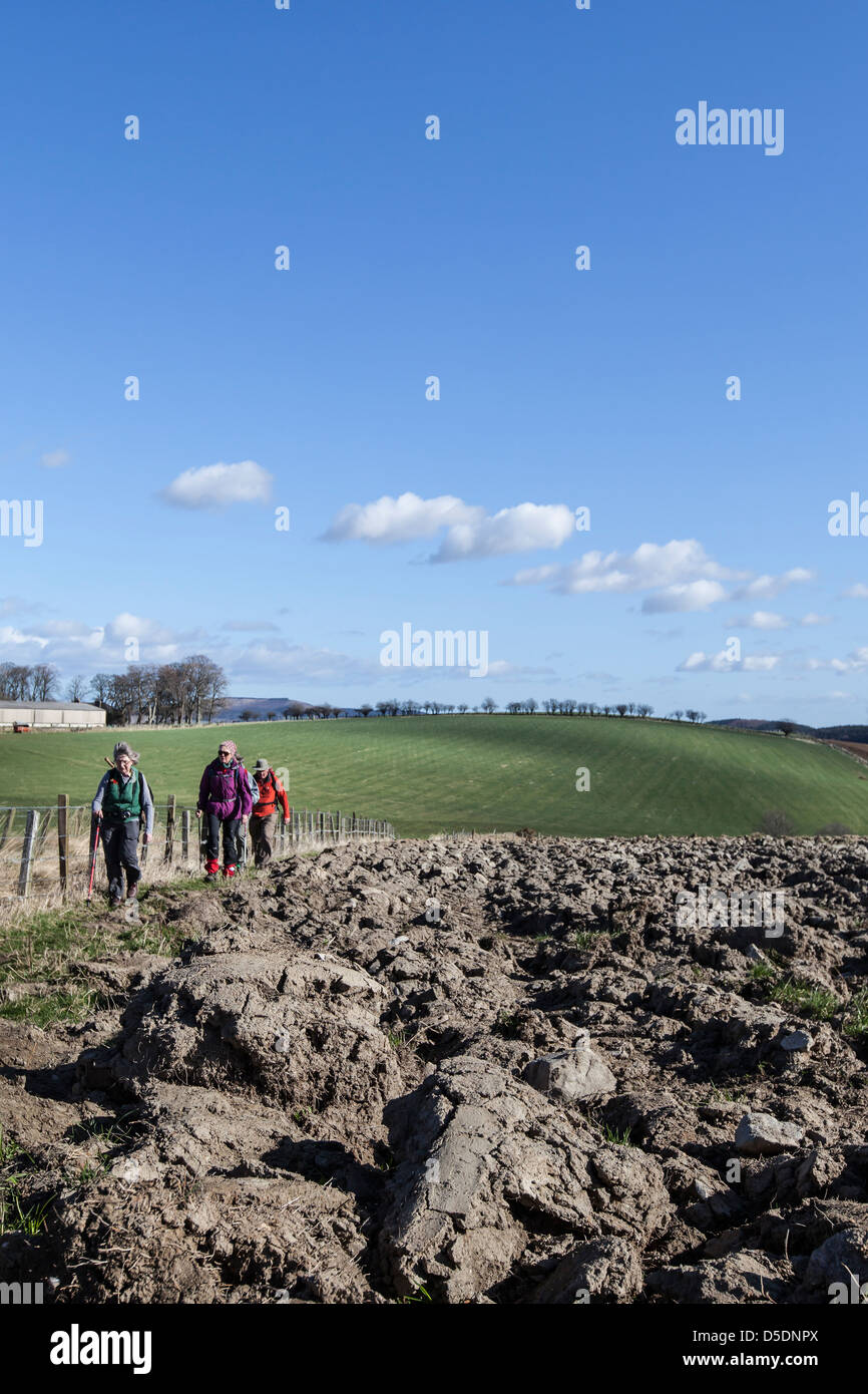 Hill-walkers on the Clashmach in Scotland. - Stock Image