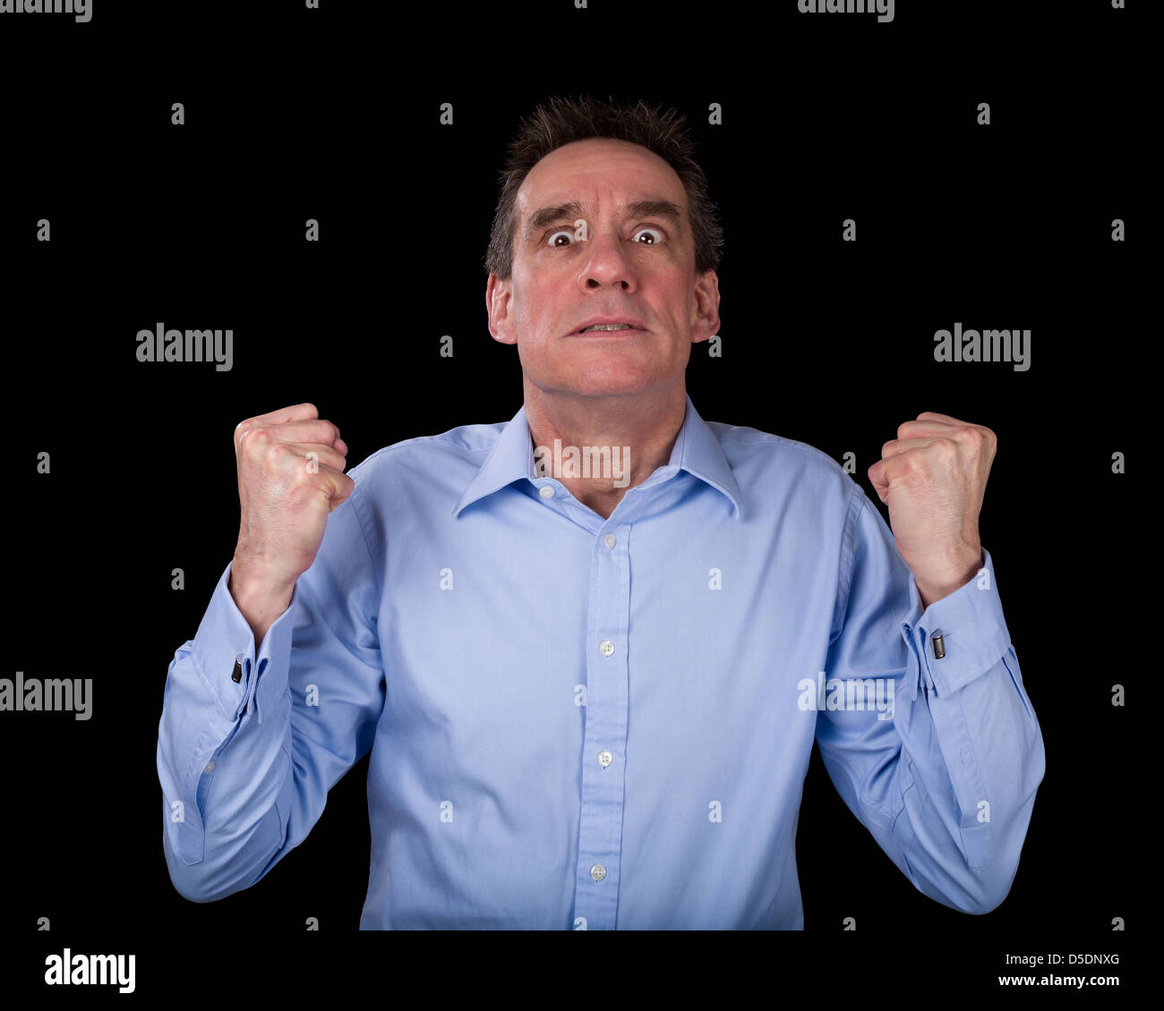 Frustrated Middle Age Business Man Shaking Fists in Anger Black Background - Stock Image