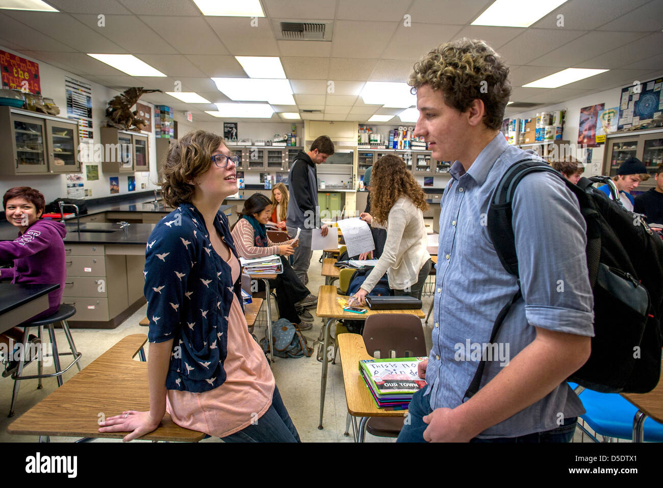 Advanced placement (AP) high school chemistry students talk before class and check their graded papers in San Clemente, - Stock Image