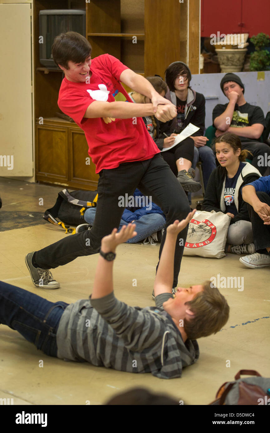 Two high school drama drama students perform improvisational theatre for their classmates in San Clemente, CA. - Stock Image
