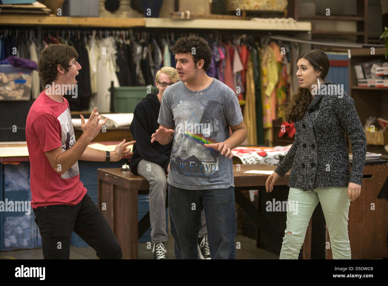 Three high school drama drama students perform improvisational theatre for their classmates in San Clemente, CA - Stock Image